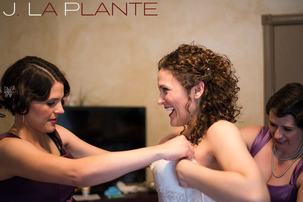 J. La Plante Photo | Brook Forest Inn Wedding | Evergreen, CO wedding photography | Bride getting into dress