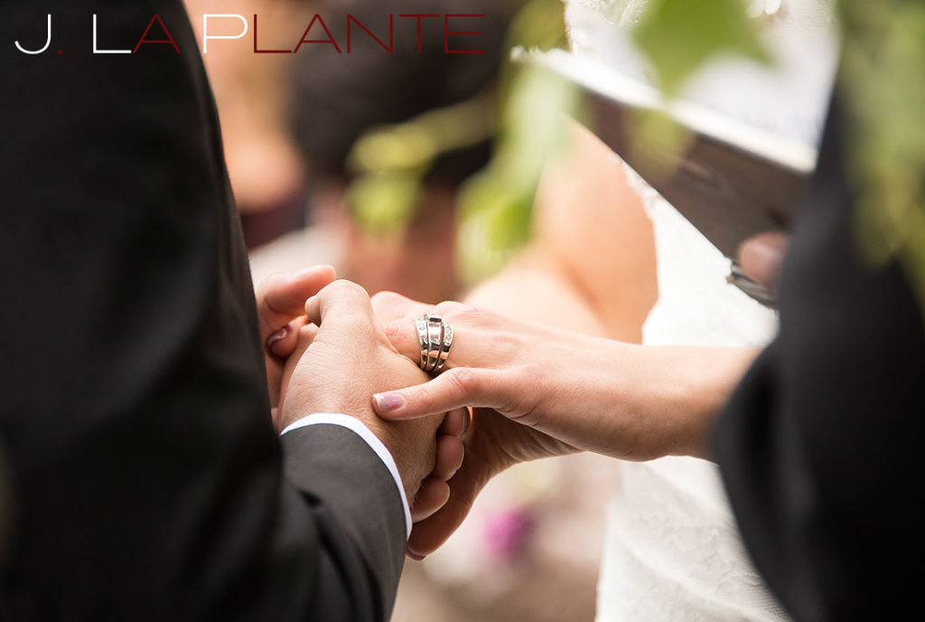 J. La Plante Photo | Brook Forest Inn Wedding | Evergreen, CO wedding photography | Groom placing ring on bride's finger