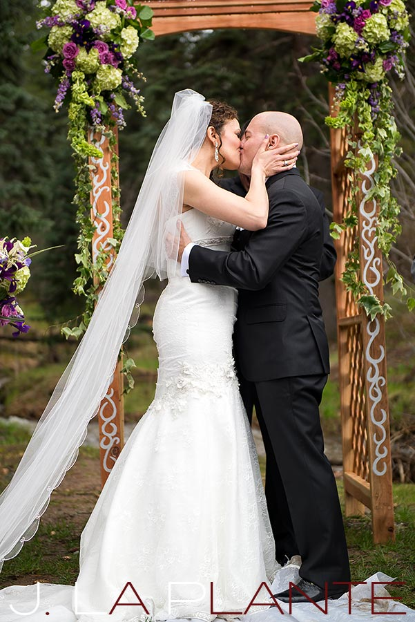 J. La Plante Photo | Brook Forest Inn Wedding | Evergreen, CO wedding photography | First kiss as a married couple