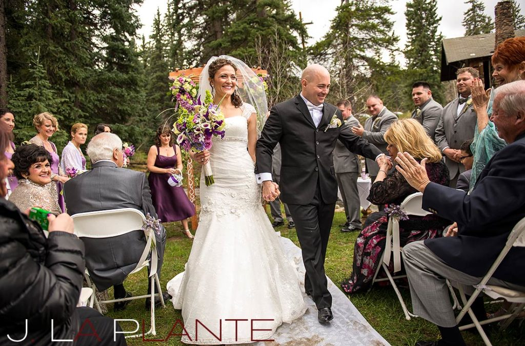 J. La Plante Photo | Brook Forest Inn Wedding | Evergreen, CO wedding photography | Bride and groom during recessional