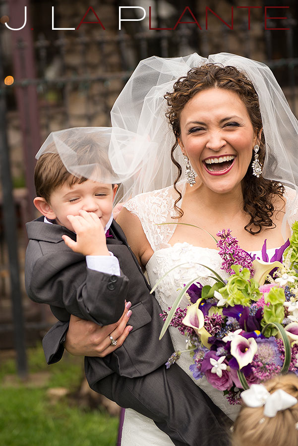J. La Plante Photo | Brook Forest Inn Wedding | Evergreen, CO wedding photography | Bride laughing with ring bearer