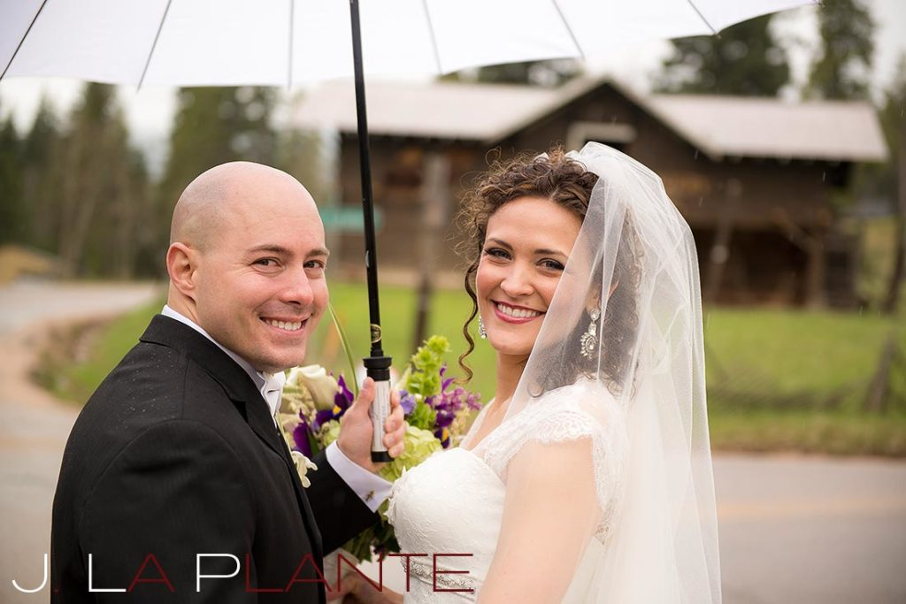 J. La Plante Photo | Brook Forest Inn Wedding | Evergreen, CO wedding photography | Bride and groom in rain