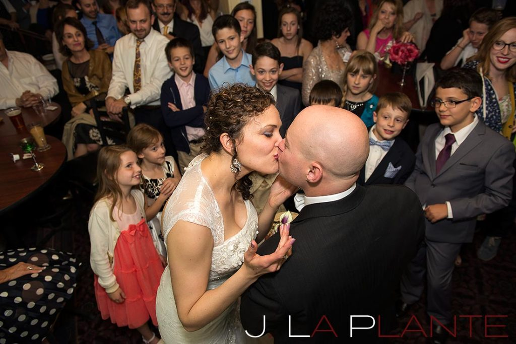J. La Plante Photo | Brook Forest Inn Wedding | Evergreen, CO wedding photography | Guests watching cake cutting