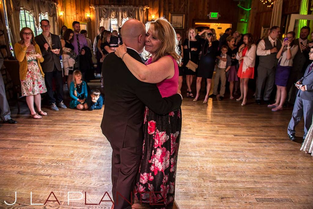 J. La Plante Photo | Brook Forest Inn Wedding | Evergreen, CO wedding photography | Groom dancing with mother