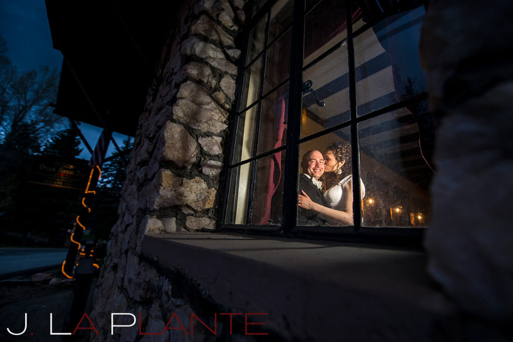 J. La Plante Photo | Brook Forest Inn Wedding | Evergreen, CO wedding photography | Bride and groom through window