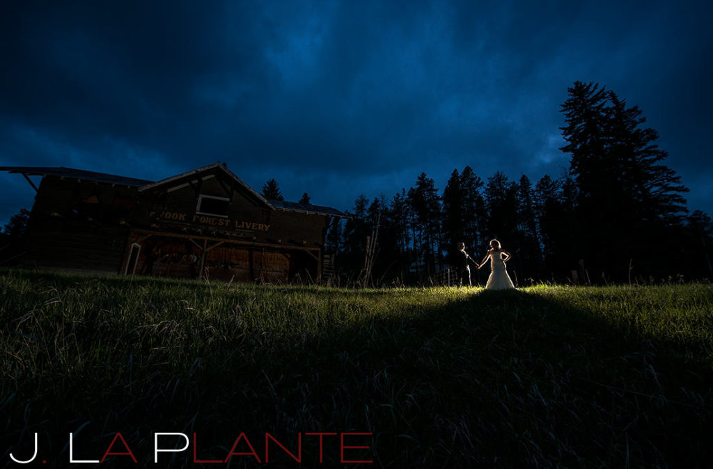 J. La Plante Photo | Brook Forest Inn Wedding | Evergreen, CO wedding photography | Bride and groom at night by barn