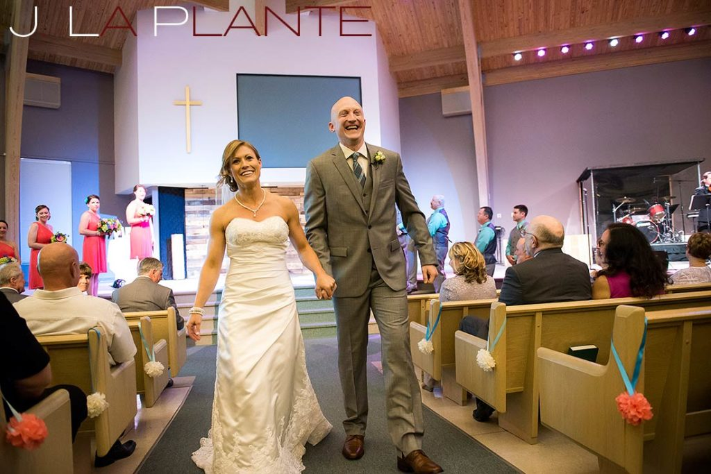 J. La Plante Photo | Kalamazoo Country Club Wedding | Destination Wedding Photography | Bride and groom leaving ceremony