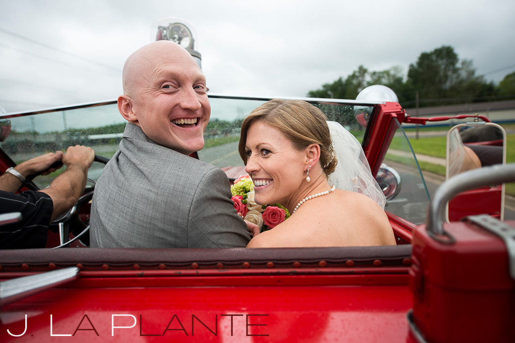 J. La Plante Photo | Kalamazoo Country Club Wedding | Destination Wedding Photography | Bride and groom on fire truck