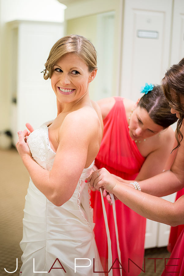 J. La Plante Photo | Kalamazoo Country Club Wedding | Destination Wedding Photography | Bride getting into dress