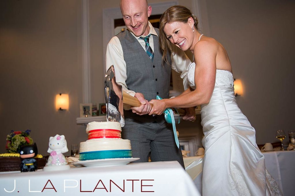 J. La Plante Photo | Kalamazoo Country Club Wedding | Destination Wedding Photography | Bride and groom cutting cake with axe
