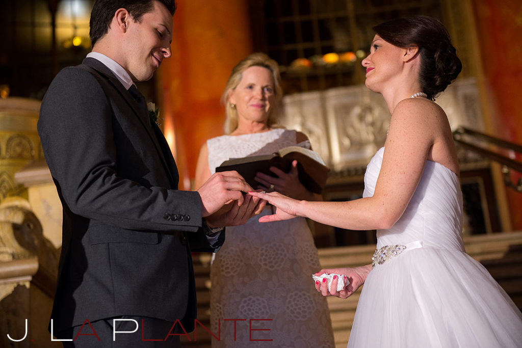 J. La Plante Photo | Fox Theatre Detroit Elopement | Destination Wedding Photography | Groom placing ring on bride's finger