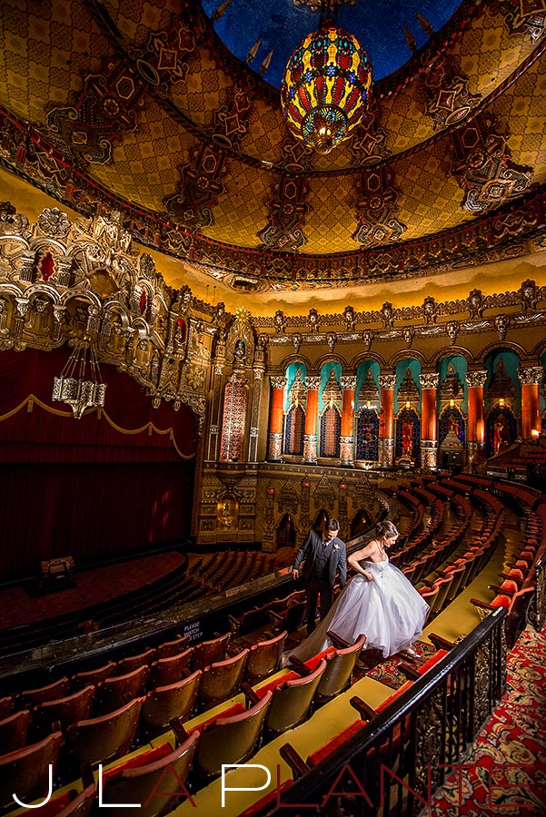 J. La Plante Photo | Fox Theatre Detroit Elopement | Destination Wedding Photography | Groom helping bride with dress