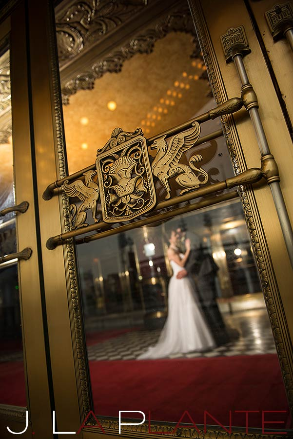 J. La Plante Photo | Fox Theatre Detroit Elopement | Destination Wedding Photography | Bride and groom through window