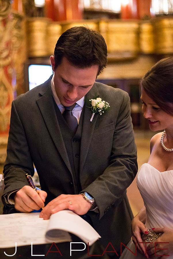 J. La Plante Photo | Fox Theatre Detroit Elopement | Destination Wedding Photography | Bride and groom signing marriage license