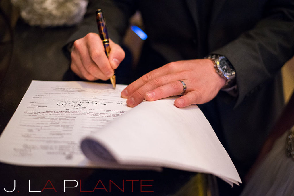 J. La Plante Photo | Fox Theatre Detroit Elopement | Destination Wedding Photography | Signing marriage license