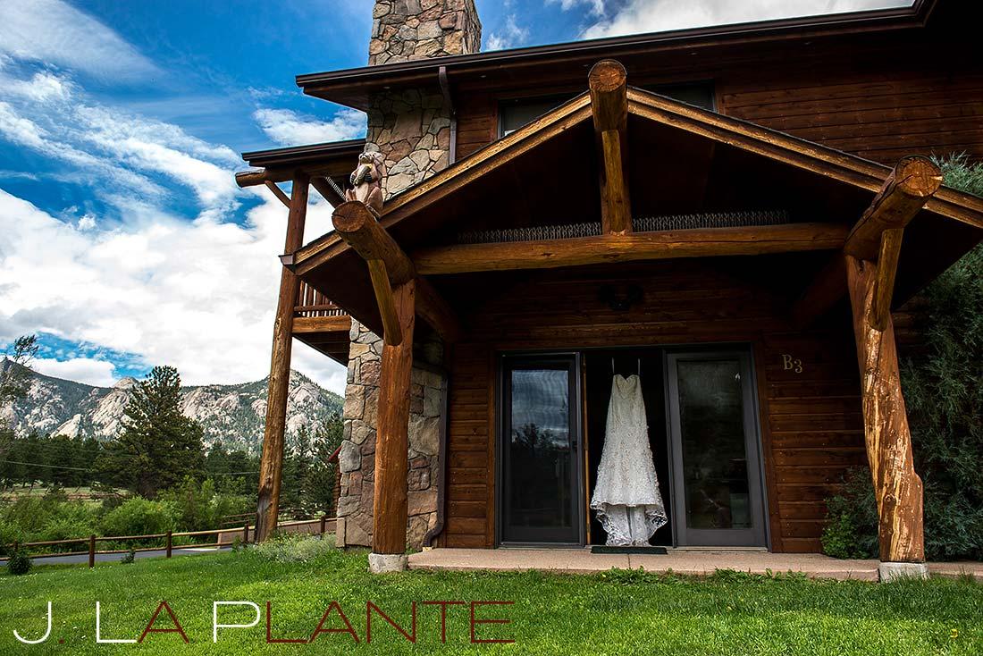 J. La Plante Photo | Colorado Rocky Mountain wedding photography | Estes Park wedding | Dress hanging outside cabin