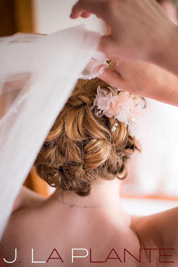 J. La Plante Photo | Colorado Rocky Mountain wedding photography | Estes Park wedding | Putting on the veil