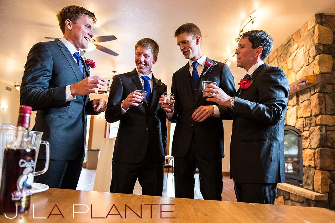 J. La Plante Photo | Colorado Rocky Mountain wedding photography | Estes Park wedding | Groom toasting with groomsmen