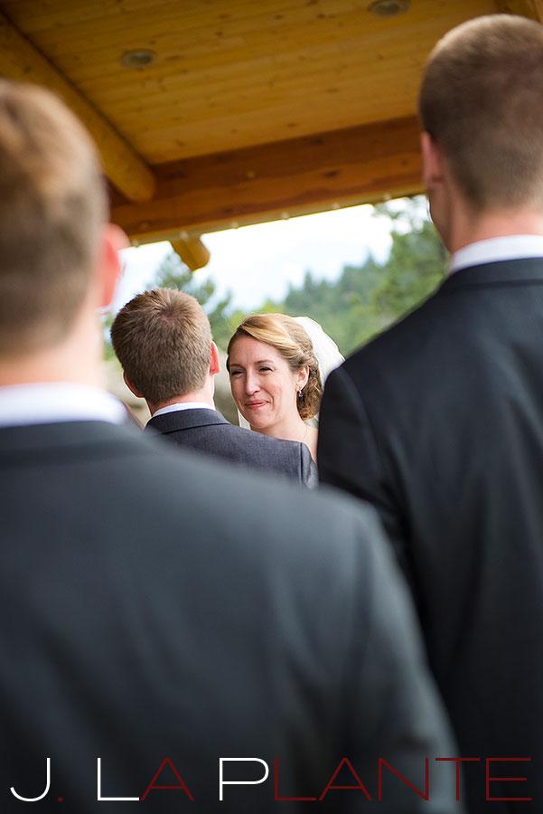 J. La Plante Photo | Colorado Rocky Mountain wedding photography | Estes Park wedding | Bride saying vows