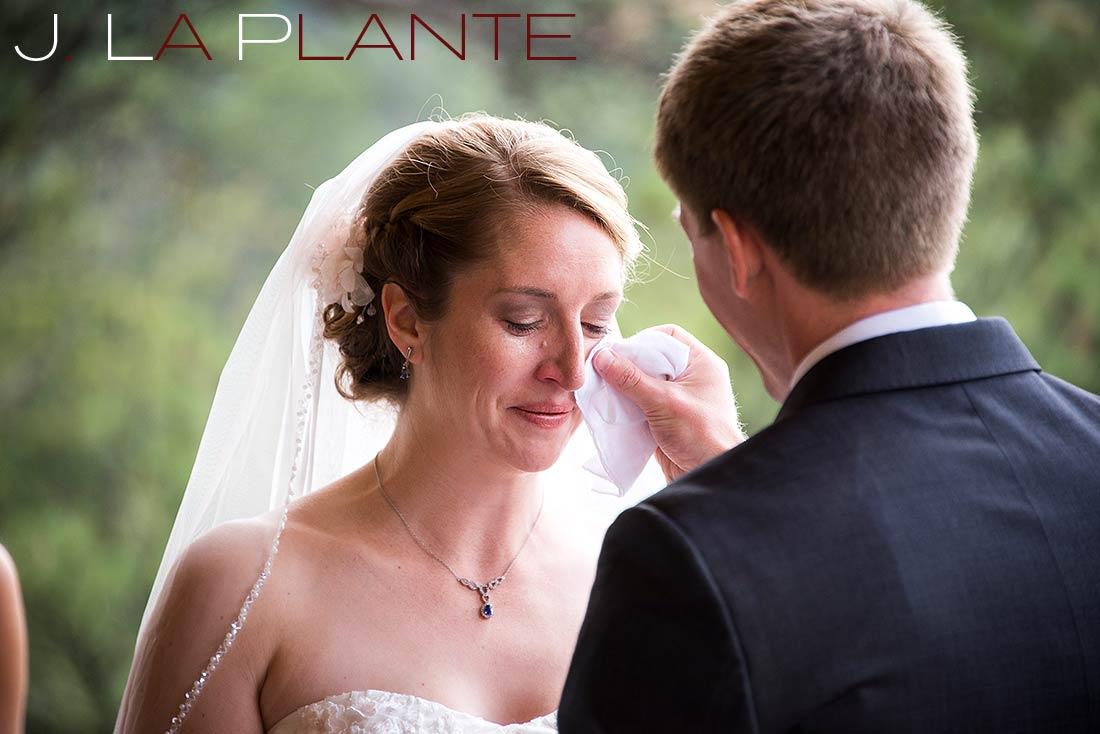 J. La Plante Photo | Colorado Rocky Mountain wedding photography | Estes Park wedding | Groom wiping tear from bride's eye