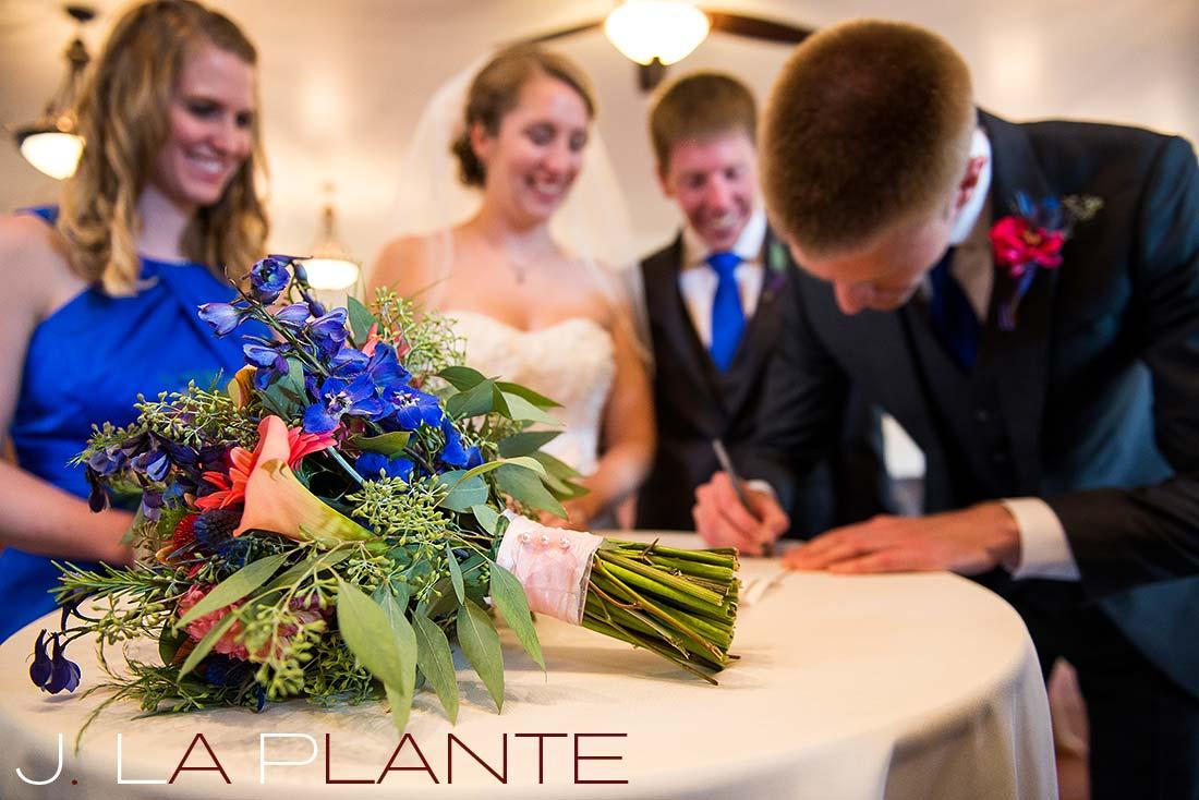 J. La Plante Photo | Colorado Rocky Mountain wedding photography | Estes Park wedding | Signing the marriage license