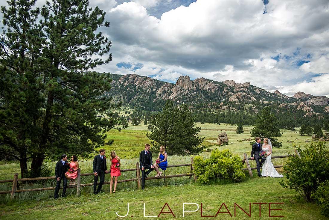 J. La Plante Photo | Colorado Rocky Mountain wedding photography | Estes Park wedding | Wedding party sitting on fence
