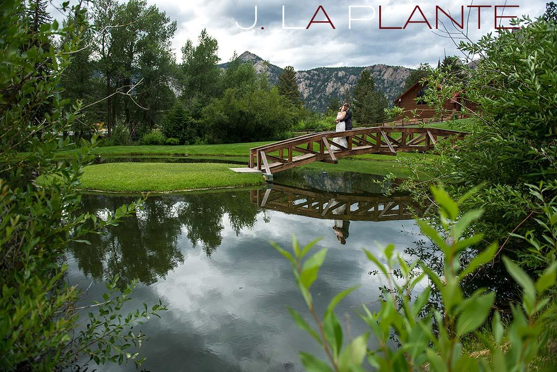 J. La Plante Photo | Colorado Rocky Mountain wedding photography | Estes Park wedding | Bride and groom on bridge over pond