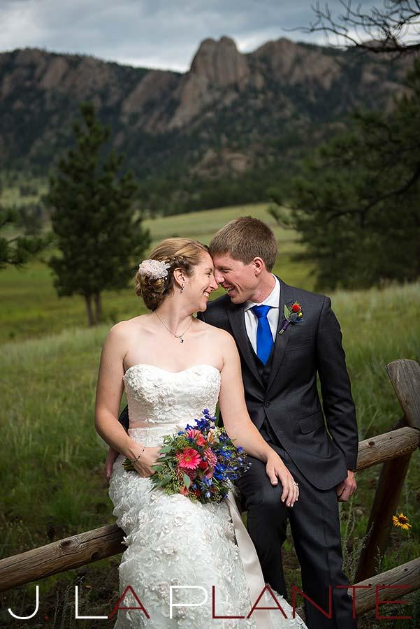 J. La Plante Photo | Colorado Rocky Mountain wedding photography | Estes Park wedding | Bride and groom on fence