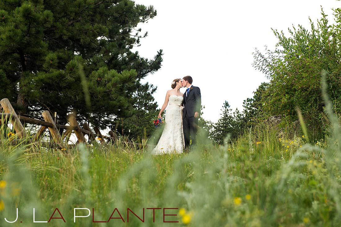 J. La Plante Photo | Colorado Rocky Mountain wedding photography | Estes Park wedding | Bride and groom kissing