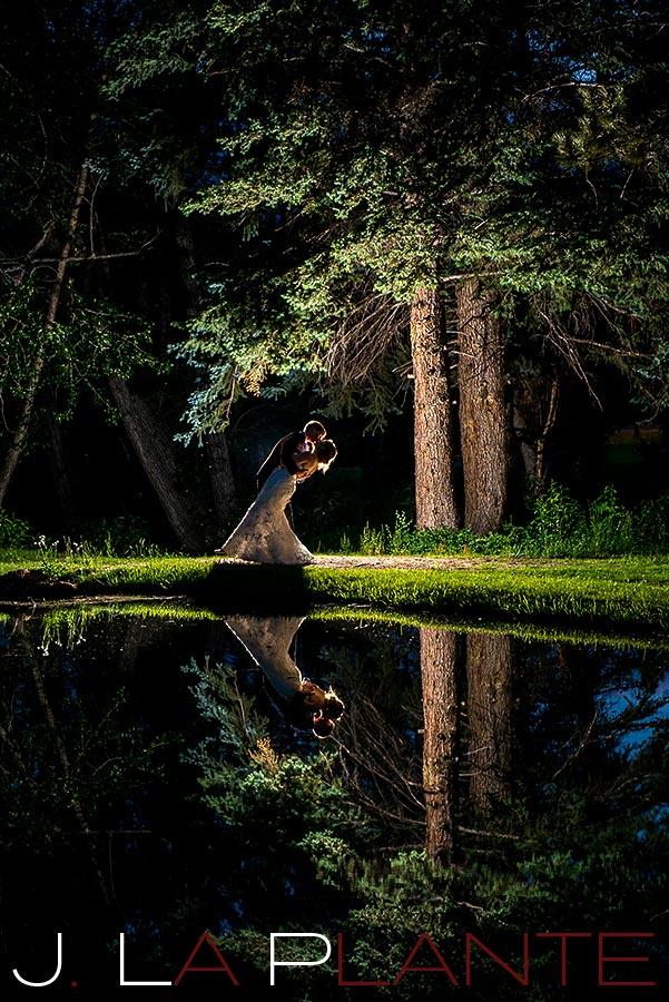 J. La Plante Photo | Colorado Rocky Mountain wedding photography | Estes Park wedding | Bride and groom by pond at night
