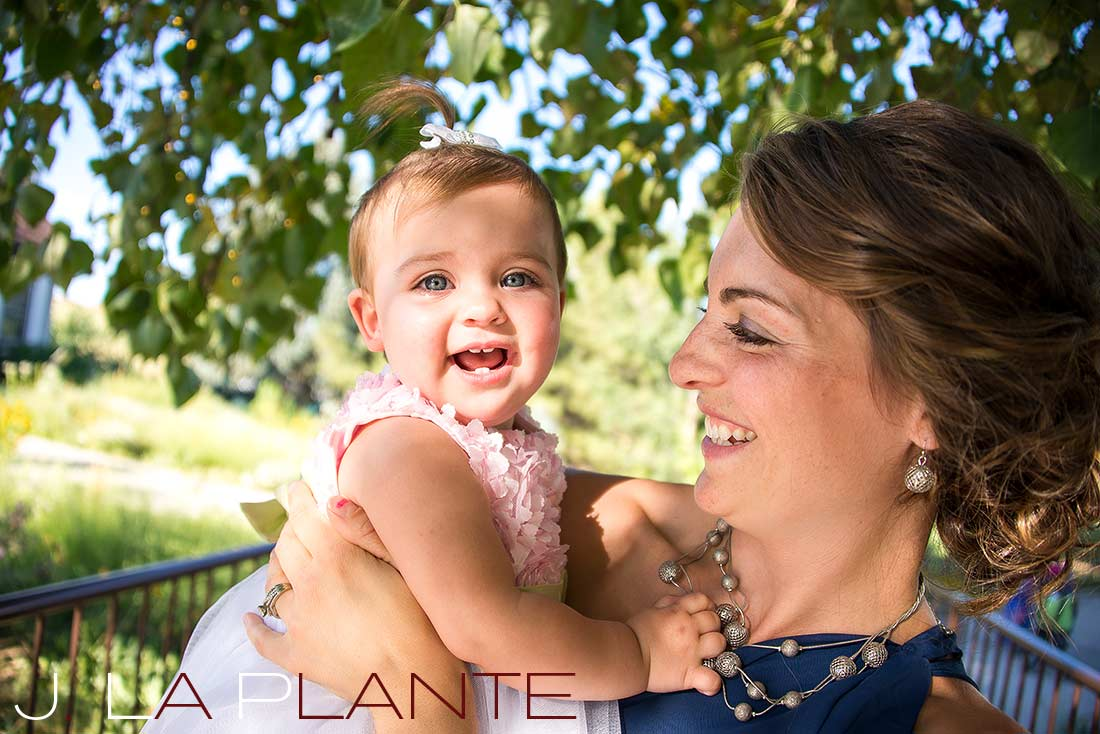 J. La Plante Photo   Denver Wedding Photography   Chatfield Botanic Gardens wedding   Bridesmaid with baby