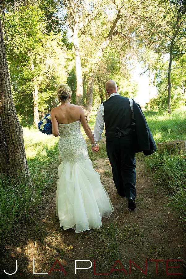 J. La Plante Photo   Denver Wedding Photography   Chatfield Botanic Gardens wedding   Bride and groom walking down path