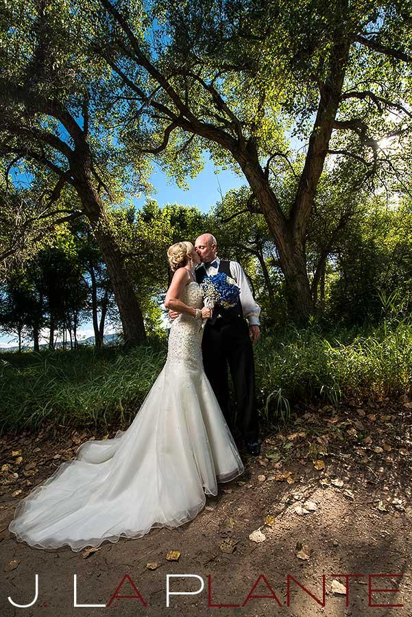 J. La Plante Photo   Denver Wedding Photography   Chatfield Botanic Gardens wedding   Bride and groom in forest