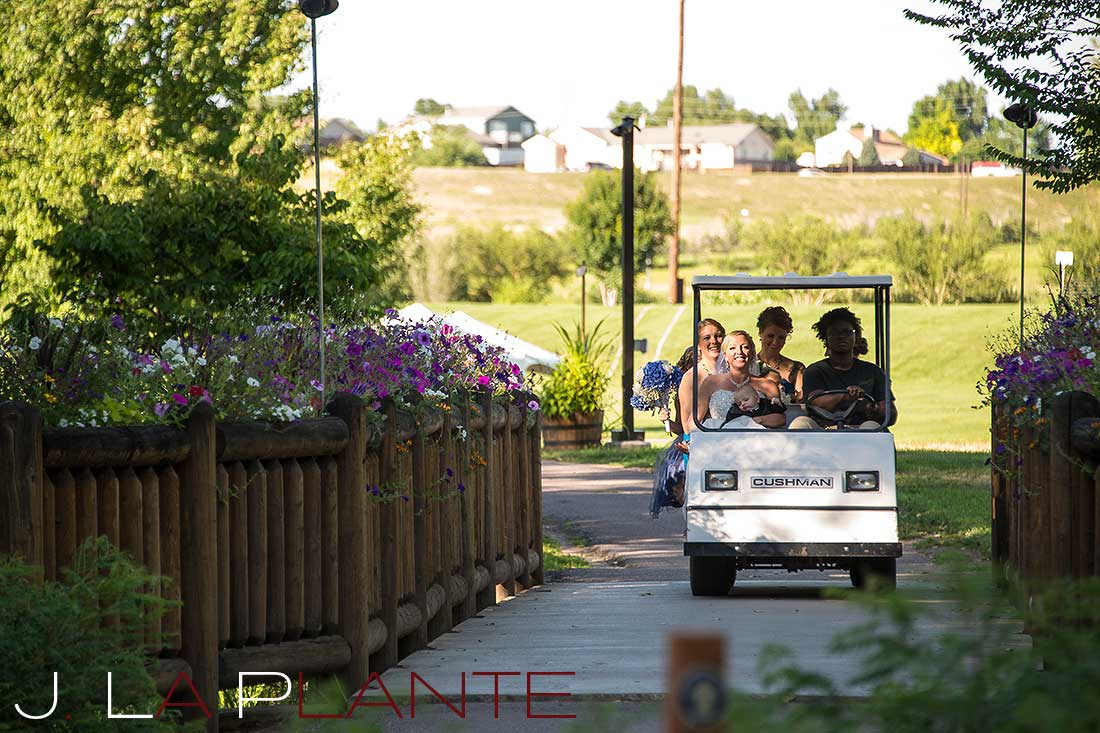 J. La Plante Photo   Denver Wedding Photography   Chatfield Botanic Gardens wedding   Bridal party arriving on golf cart
