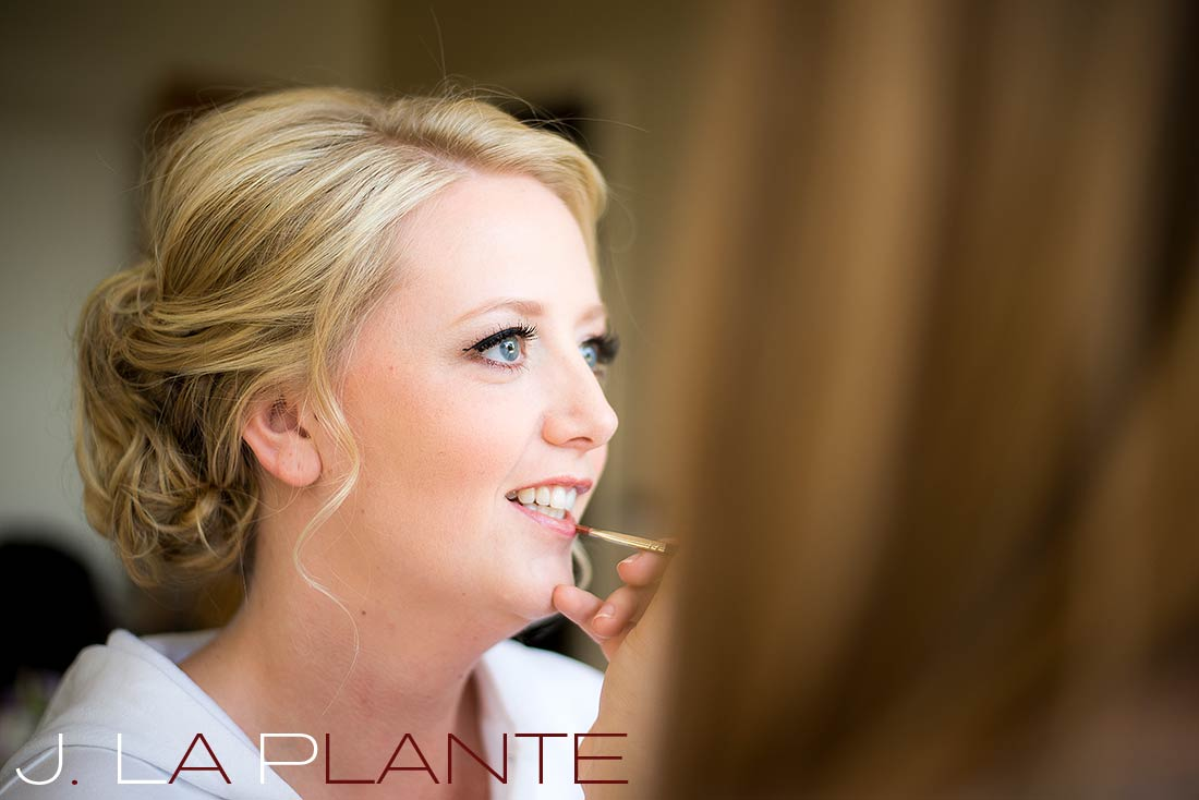 J. La Plante Photo | Denver Wedding Photography | Wildlife Experience wedding | Bride getting makeup done