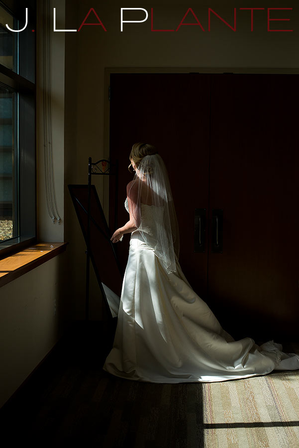 J. La Plante Photo | Denver Wedding Photography | Wildlife Experience wedding | Bride looking in mirror