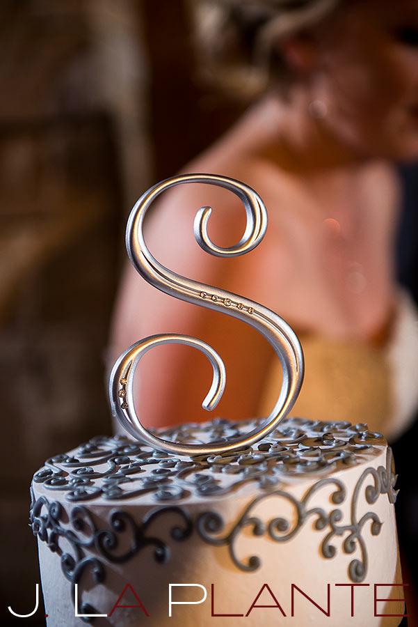 J. La Plante Photo | Denver Wedding Photography | Wildlife Experience wedding | Initial cake topper