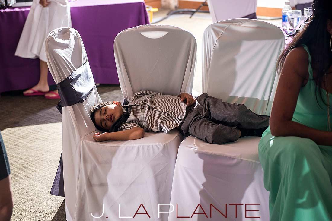 J. La Plante Photo | Denver Wedding Photography | Wildlife Experience wedding | Kid sleeping at wedding reception