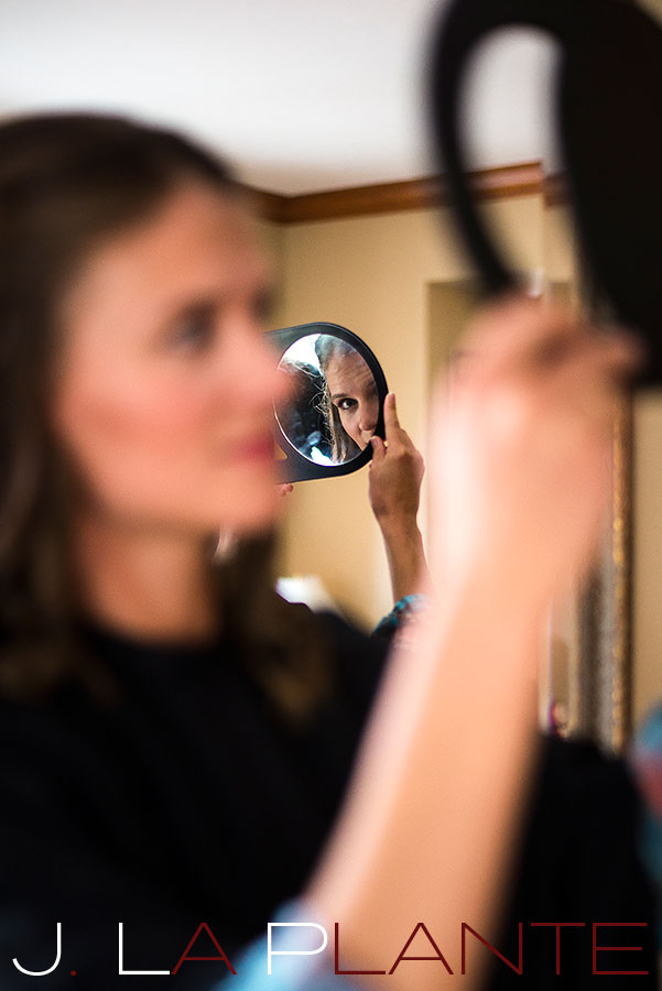 J. La Plante Photo | Colorado Rocky Mountain Wedding Photography | Copper Mountain wedding | Bride checking makeup