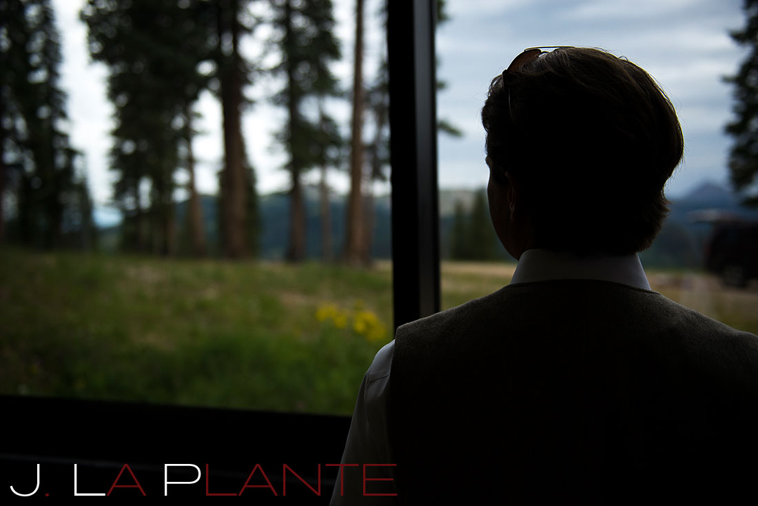 J. La Plante Photo | Colorado Rocky Mountain Wedding Photography | Copper Mountain wedding | Groom looking out window