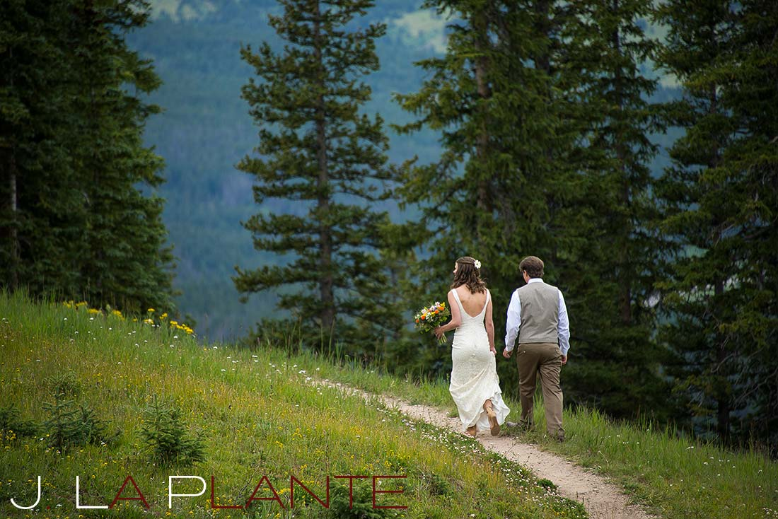 J. La Plante Photo | Colorado Rocky Mountain Wedding Photography | Copper Mountain wedding | Bride and groom walking on mountain trail