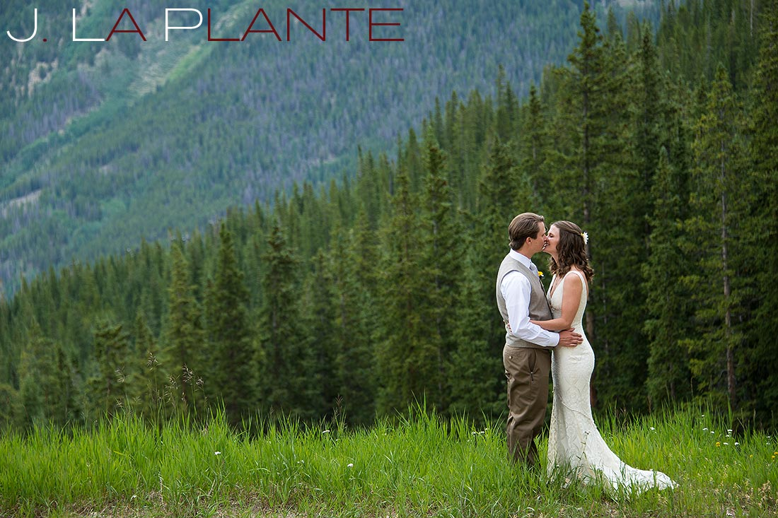 J. La Plante Photo | Colorado Rocky Mountain Wedding Photography | Copper Mountain wedding | Bride and groom in field