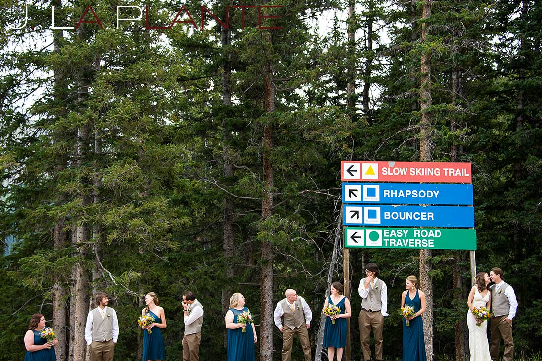 J. La Plante Photo | Colorado Rocky Mountain Wedding Photography | Copper Mountain wedding | Wedding party next to trail sign