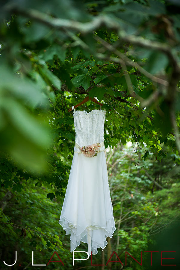 J. La Plante Photo | Destination Wedding Photography | Ogunquit Maine Wedding | Wedding gown hanging from tree