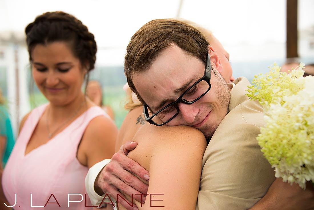 J. La Plante Photo | Destination Wedding Photography | Ogunquit Maine Wedding | Bride hugging brother