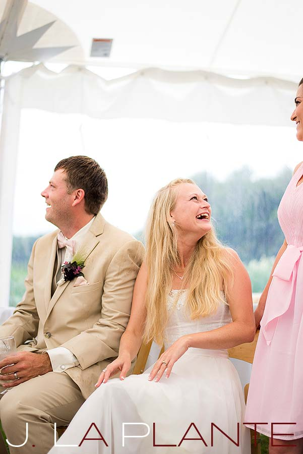 J. La Plante Photo | Destination Wedding Photography | Ogunquit Maine Wedding | Bride laughing during toasts
