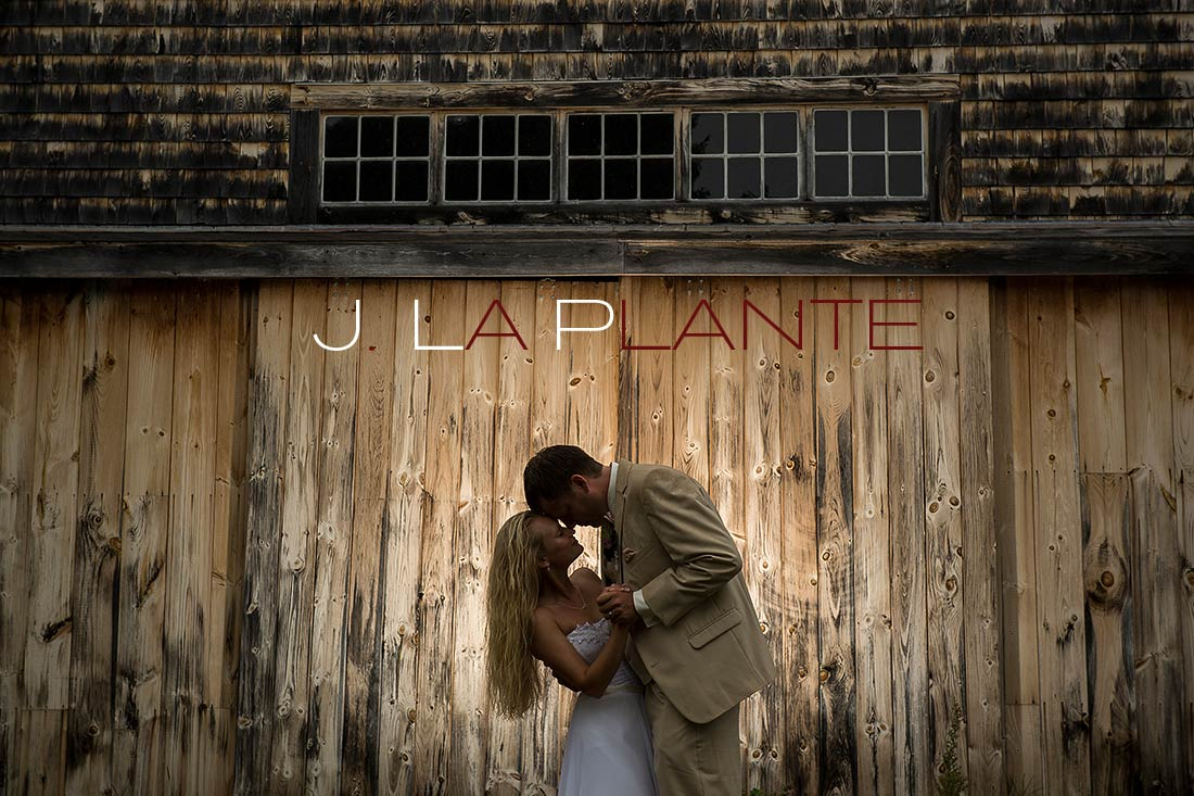 J. La Plante Photo | Destination Wedding Photography | Ogunquit Maine Wedding | Groom dipping bride in front of barn