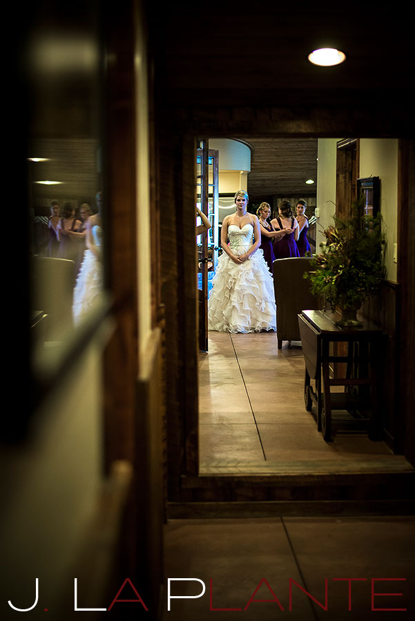 J. La Plante Photo | Colorado Wedding Photography | Spruce Mountain Ranch Wedding | Bride looking at herself in mirror