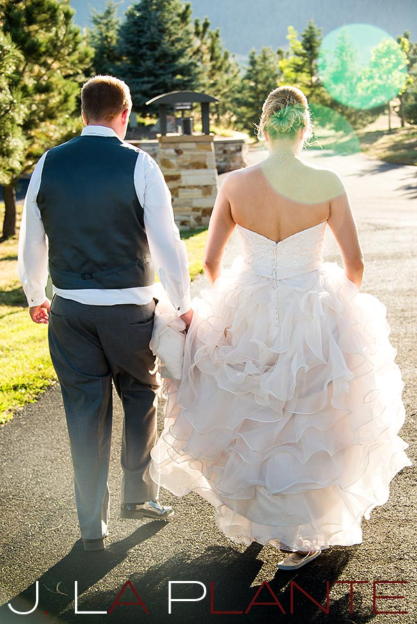 J. La Plante Photo | Colorado Wedding Photography | Spruce Mountain Ranch Wedding | Bride and groom walking down path