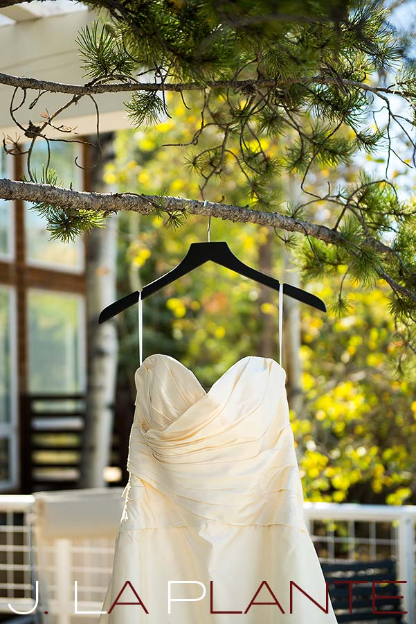 J. La Plante Photo | Aspen Wedding Photography | Aspen Meadows Resort Wedding | Wedding dress hanging in tree